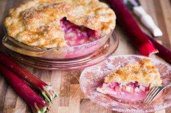 slice of fresh rhubarb pie on pink plate